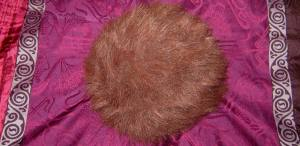 For non-Trekkies, this is a tribble, an alien ball of fur that purrs endearingly and multiplies voraciously. Also, it is a mortal enemy of the Klingon Empire.