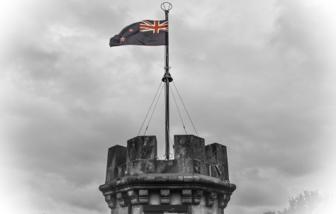 larnach castle tower new zealand flag